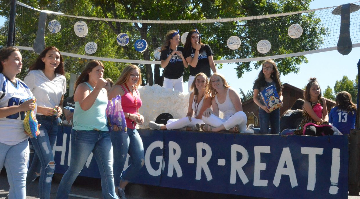 The Moffat County High School volleyball team's float is full of Bulldog pride during the Homecoming parade Friday.