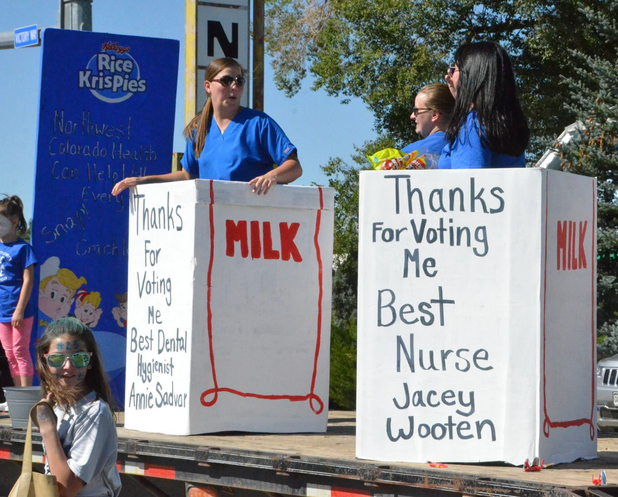 Members of Northwest Colorado Health are confined to milk cartons during Moffat County High School's Friday Homecoming parade.