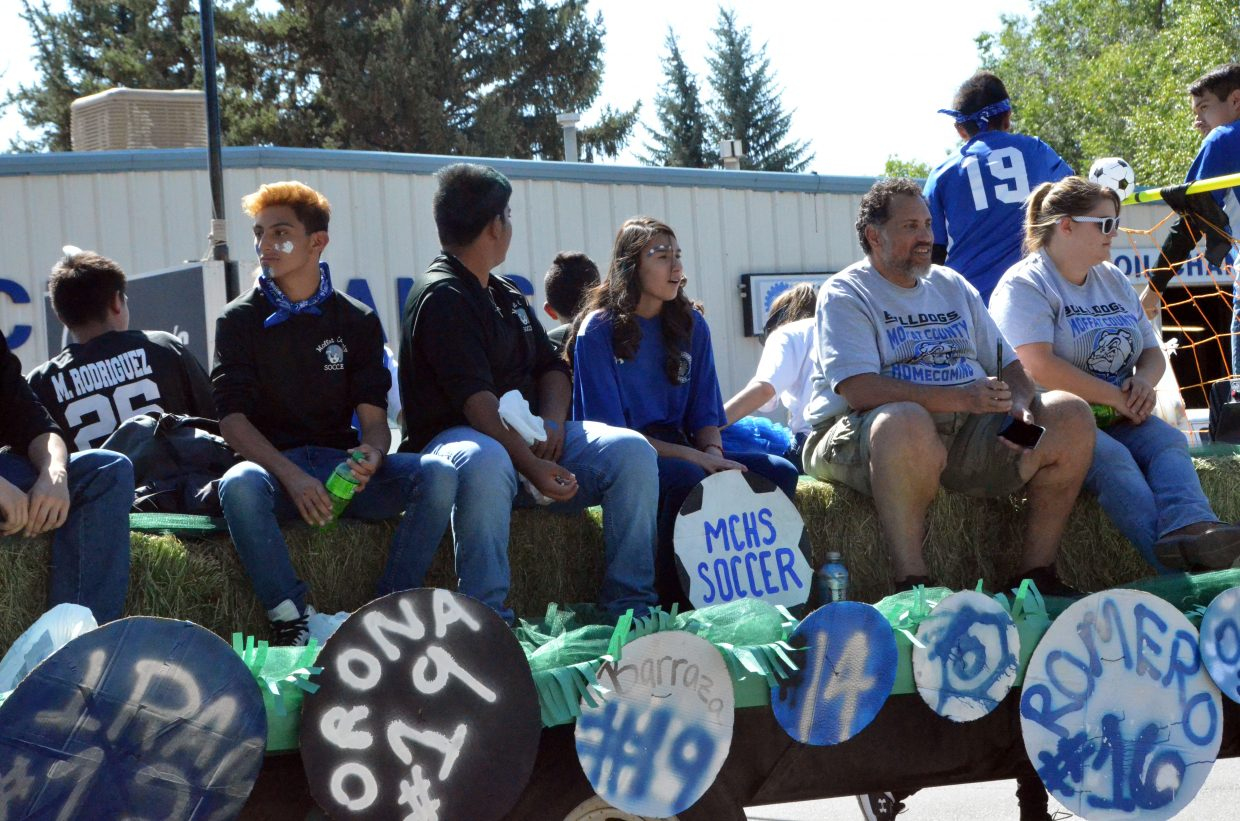 The Moffat County High School soccer team rides on their float during the Homecoming parade Friday.