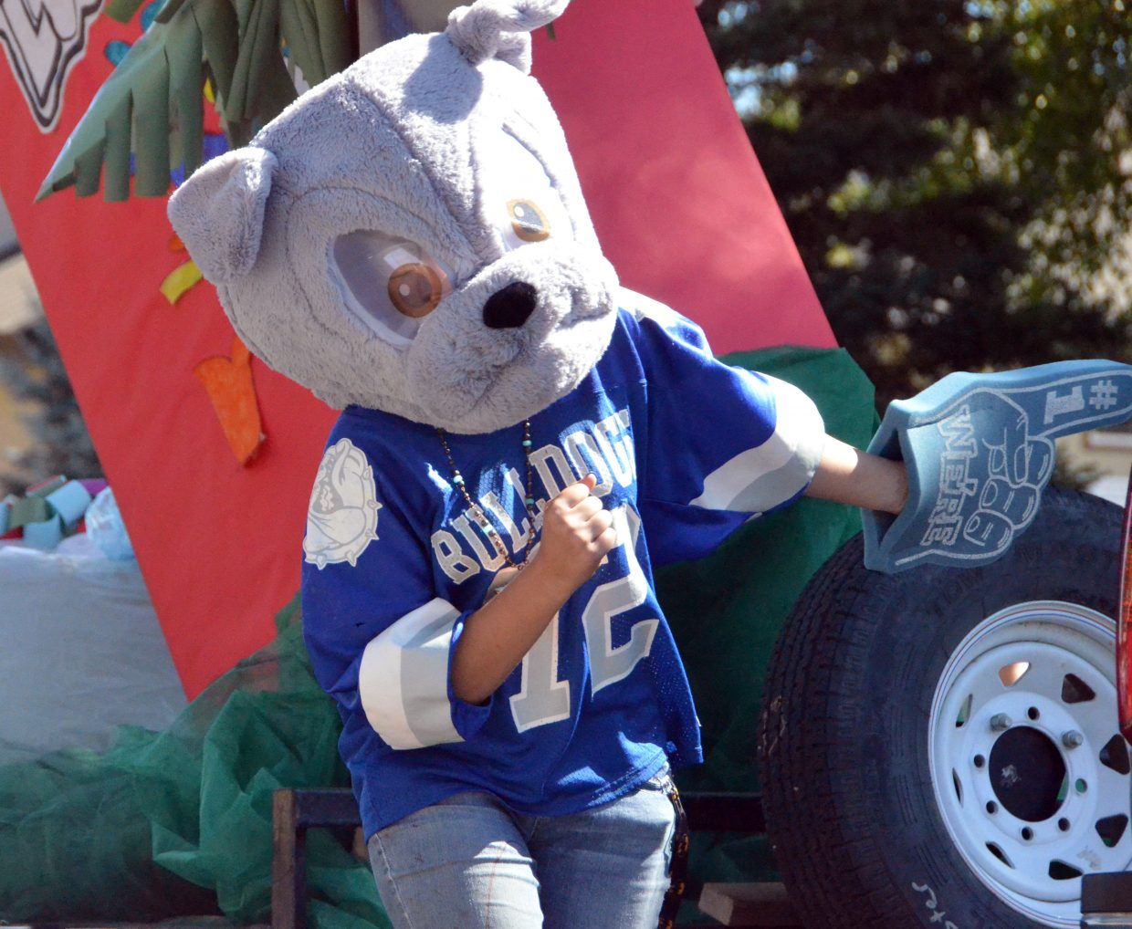 One of many Bulldog mascots marches in the Moffat County High School Homecoming parade Friday.