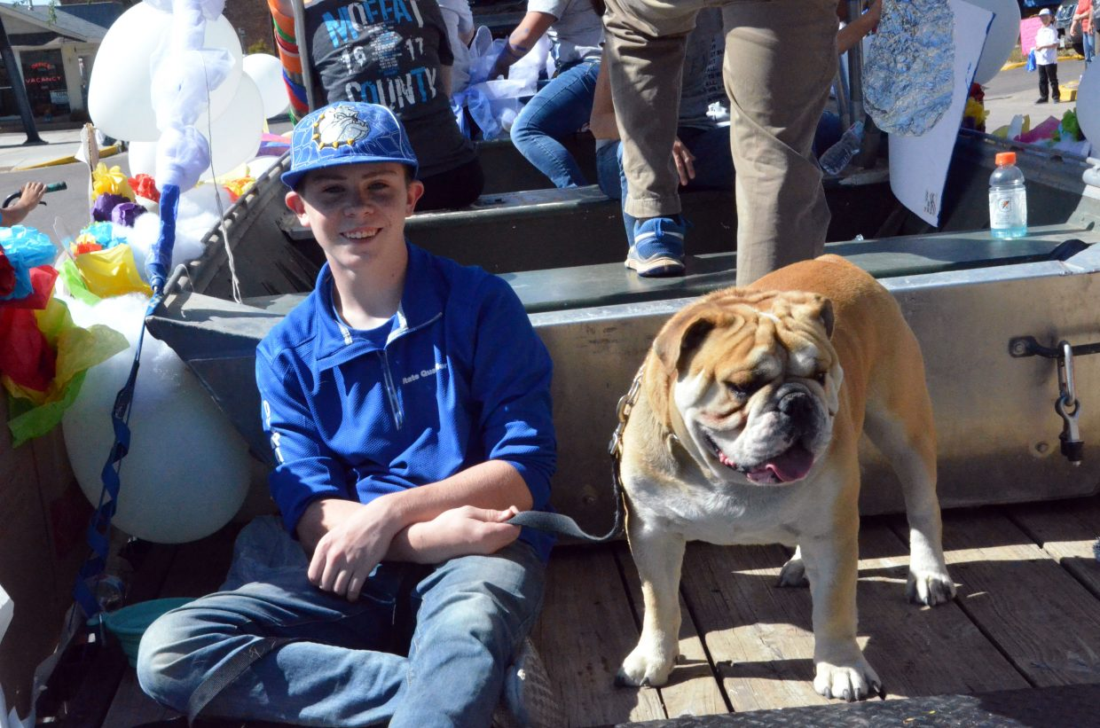 The Moffat County High School freshman class is joined by a four-legged companion during the Homecoming parade Friday.