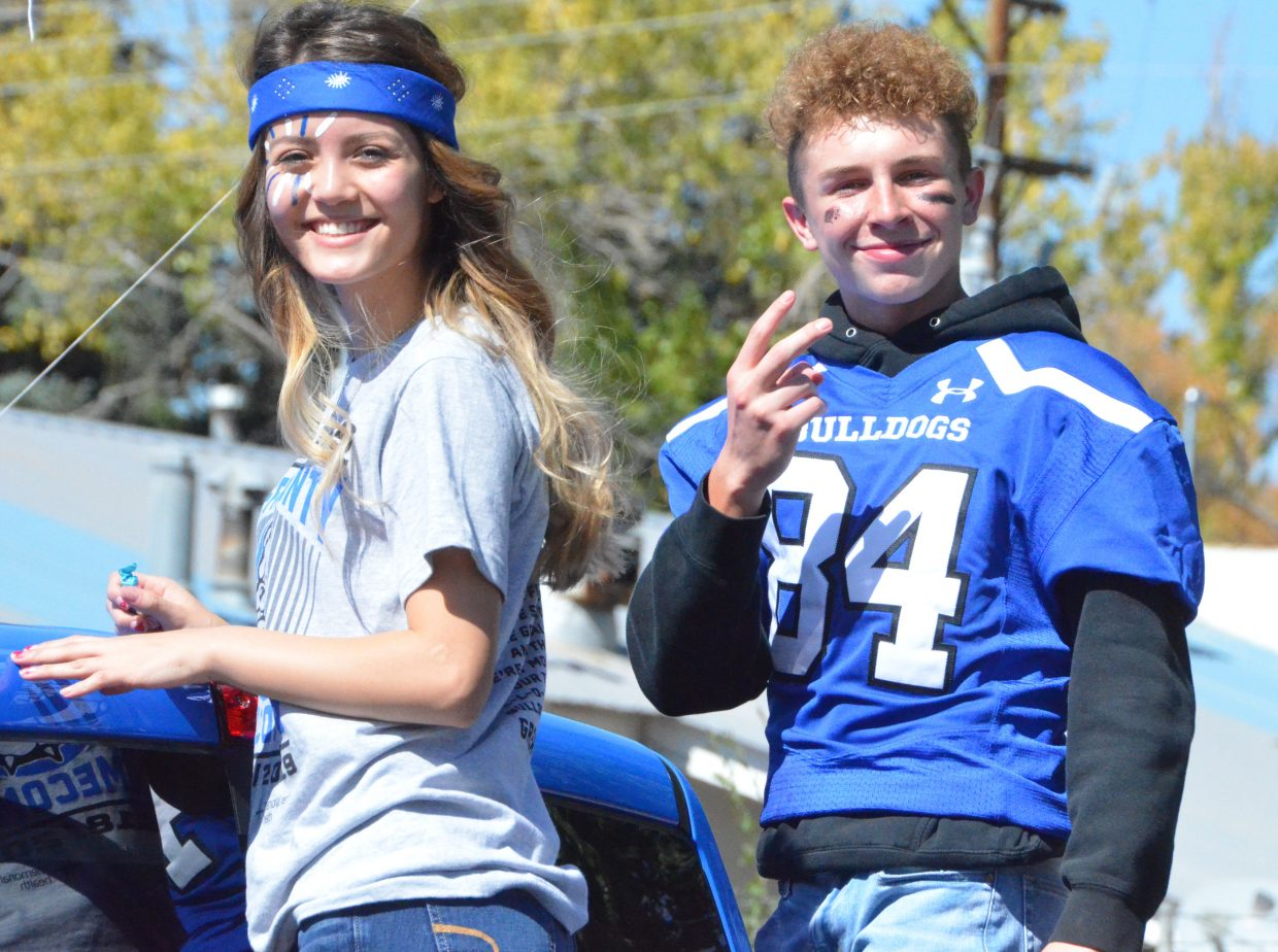 Moffat County High School's Marlyn Arellano and Dagan White serve as the junior class attendants during the Homecoming parade Friday.
