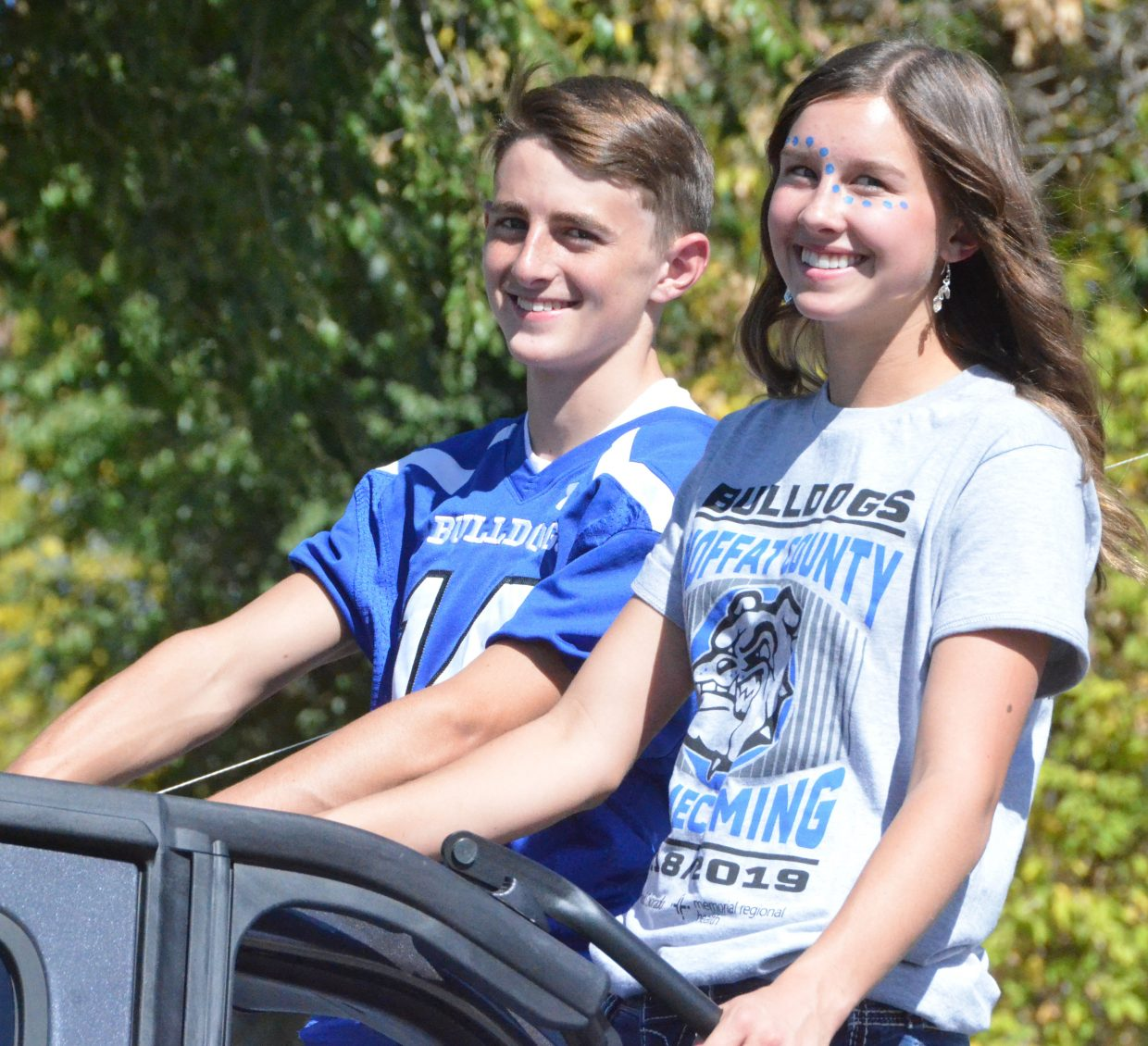 Moffat County High School's Blake Juergens and Emaleigh Papierski serve as the sophomore class attendants during the Homecoming parade Friday.
