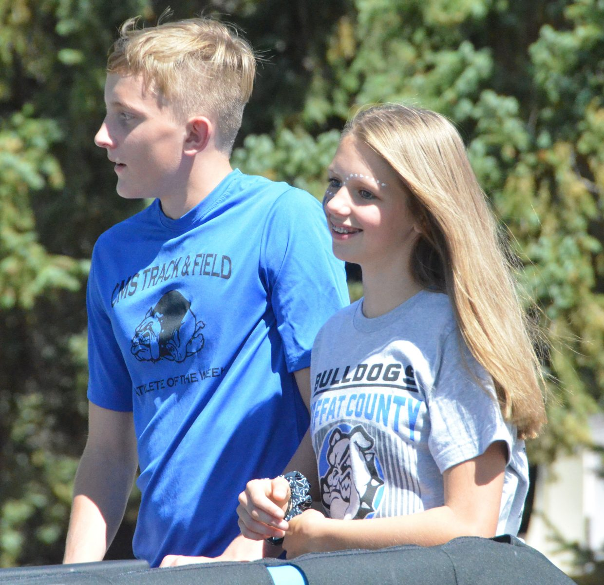 Moffat County High School's Logan Hafey and Emma Jones serve as the freshman class attendants during the Homecoming parade Friday.