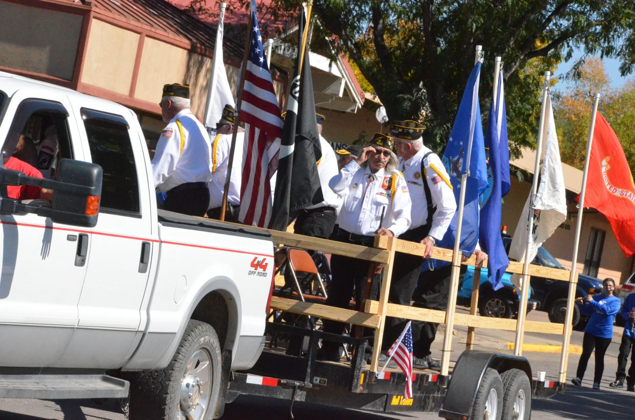 Craig veterans are the first in line during the Moffat County High School Homecoming parade Friday.