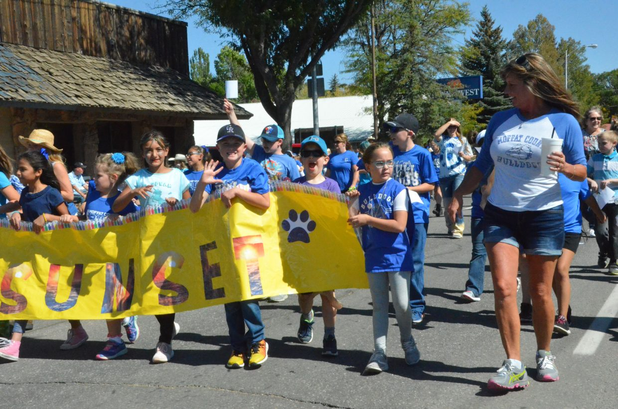 Sunset Elementary School's Peggy Green marches alongside students during the Moffat County High School Homecoming parade Friday.