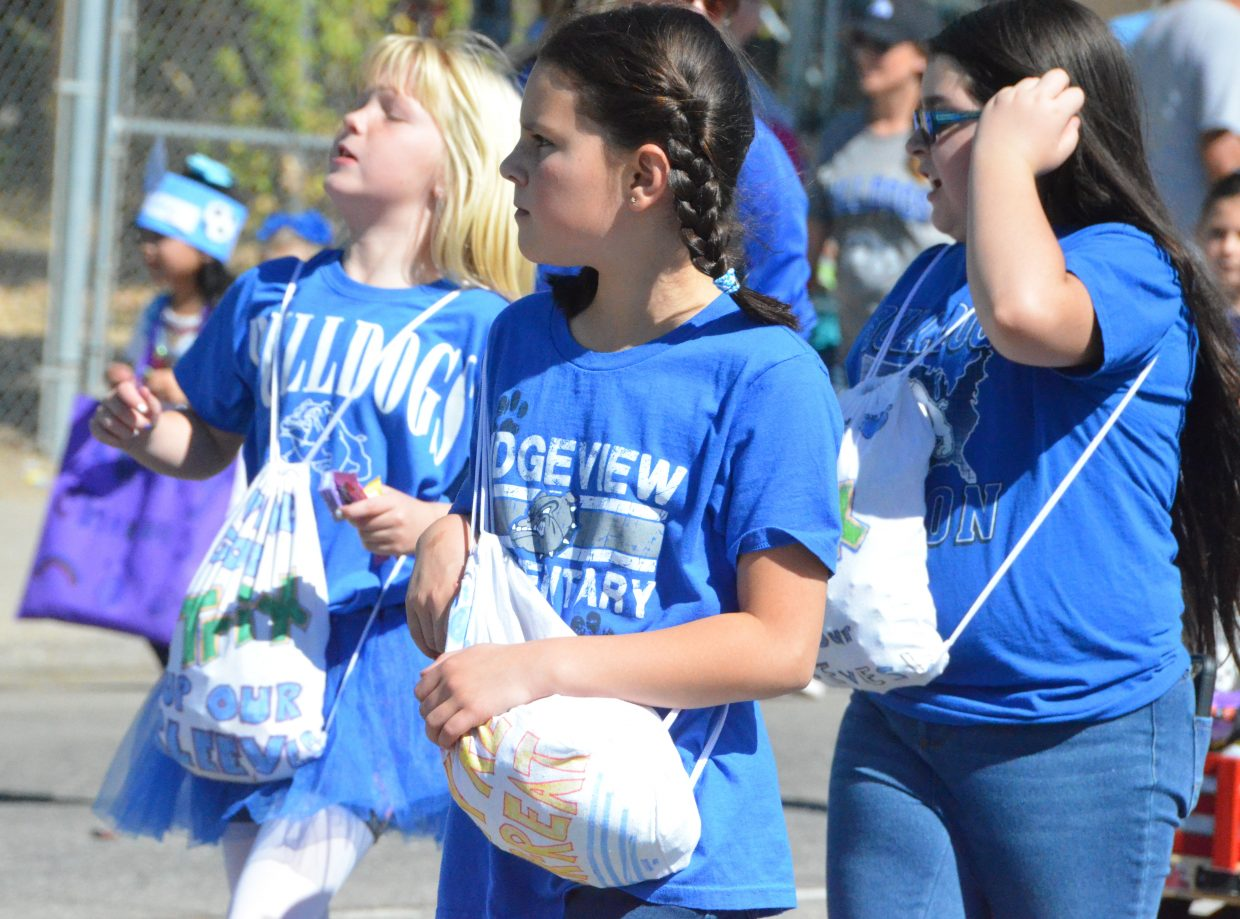 Ridgeview Elementary School students look for crowd members seeking candy during the Moffat County High School Homecoming parade Friday.