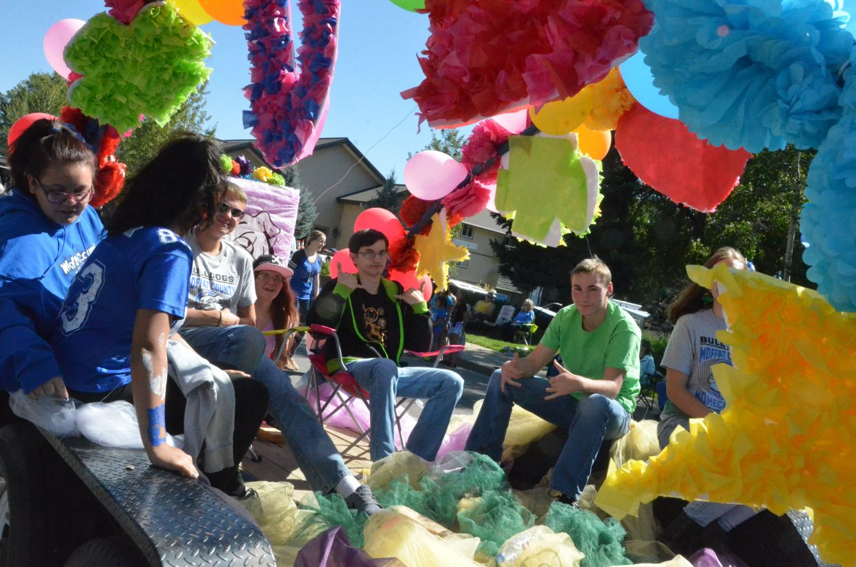A splash of color decorates the junior class float during the Moffat County High School Homecoming parade Friday.