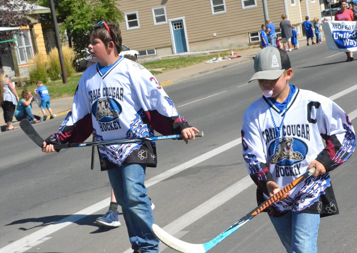 Athletes with Craig Youth Hockey Association march along during Moffat County High School's Friday Homecoming parade.