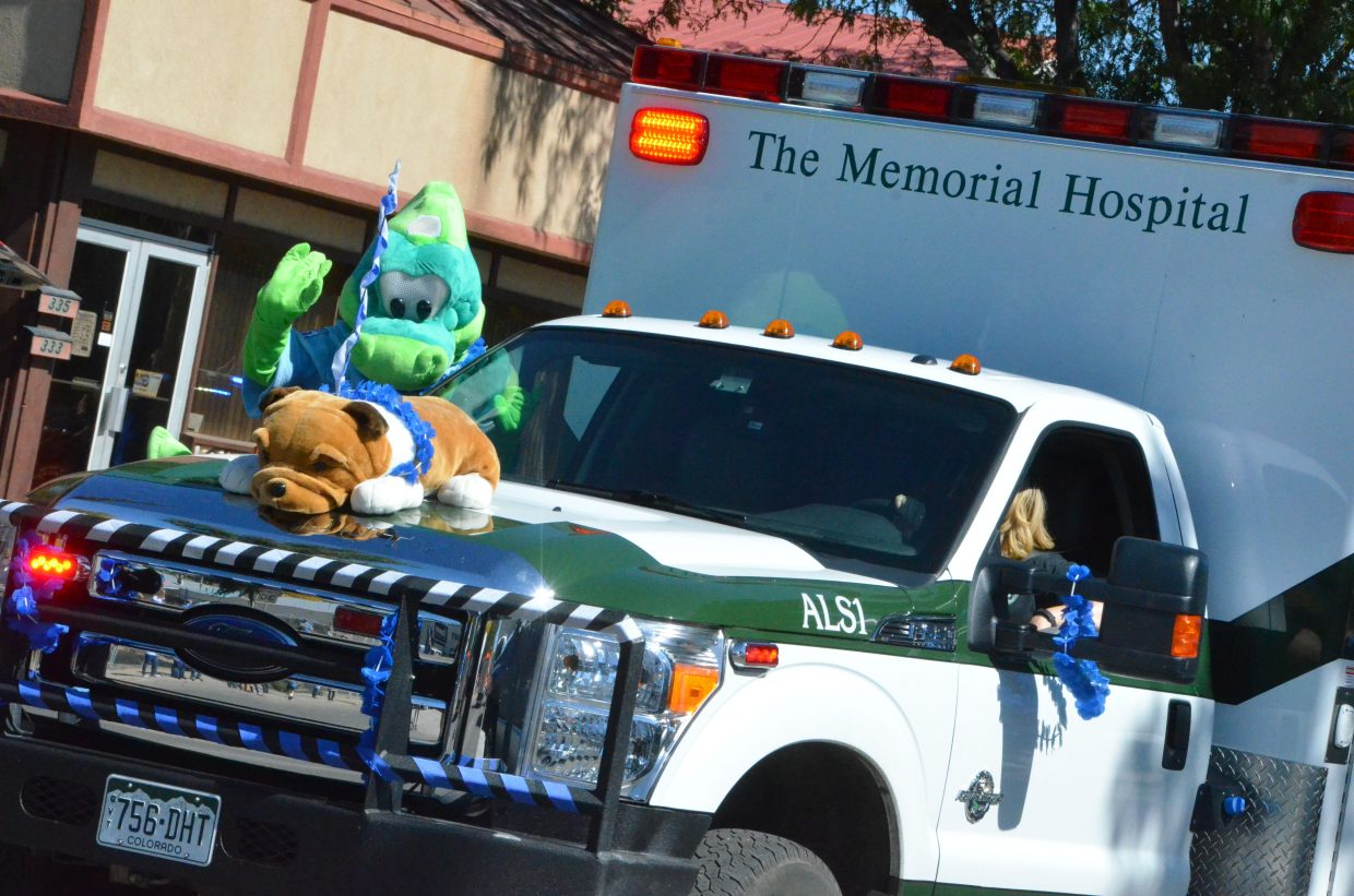 A Memorial Regional Health ambulance is among the vehicles to start off the Moffat County High School Homecoming parade Friday.