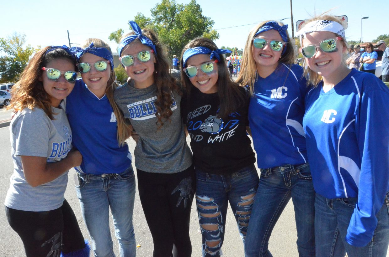 Craig Middle School students wear plenty of blue and white and other Bulldog gear during Moffat County High School's Friday Homecoming parade.
