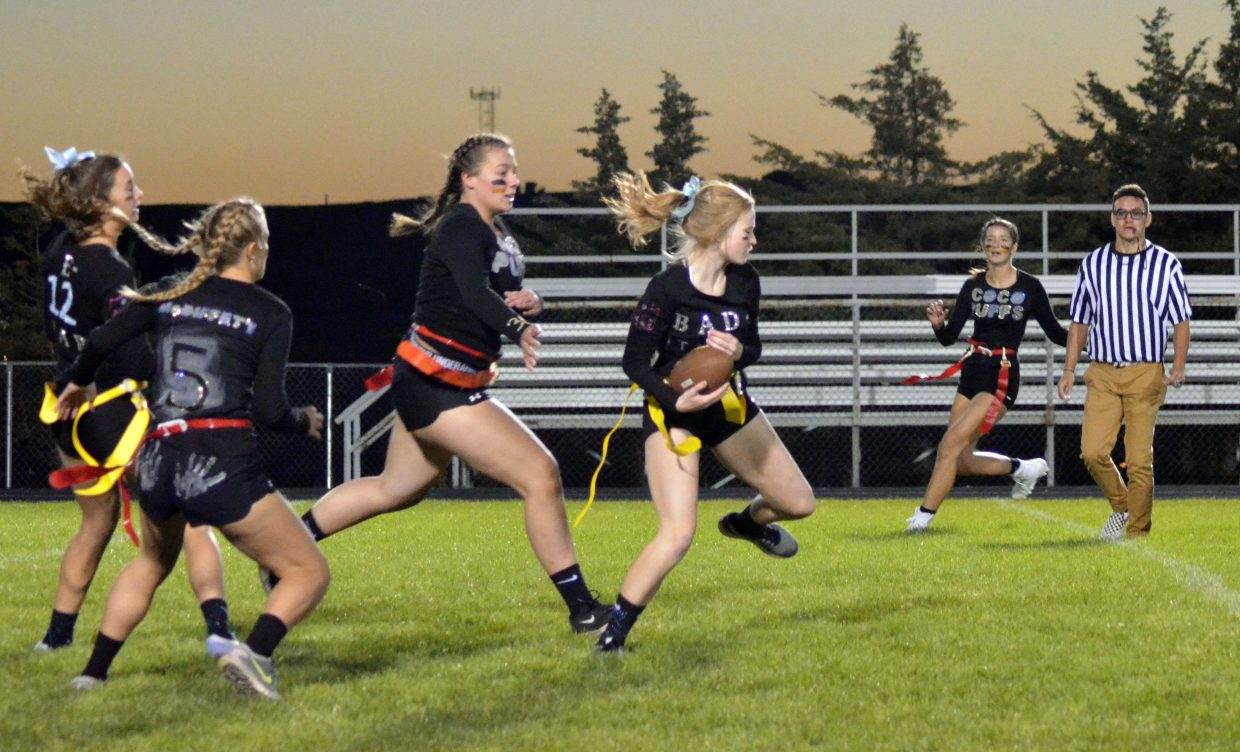 Reese Weber, of Bad-Itudes pulls in an interception during Moffat County High School's Monday Powder Puff Football.