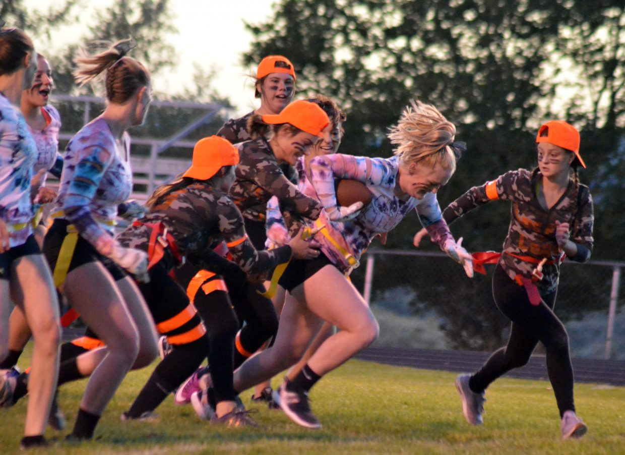 Cereal Killers' Jaidyn Steele looks for a couple more yards against Locked & Loaded during Moffat County High School's Monday Powder Puff Football.