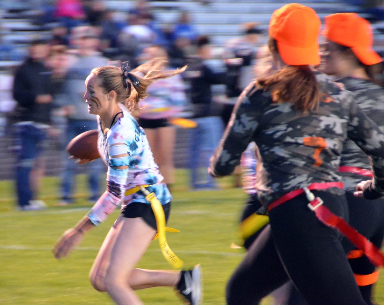 Madie Weber, of Cereal Killers, speeds to the goal line during Moffat County High School's Monday Powder Puff Football.