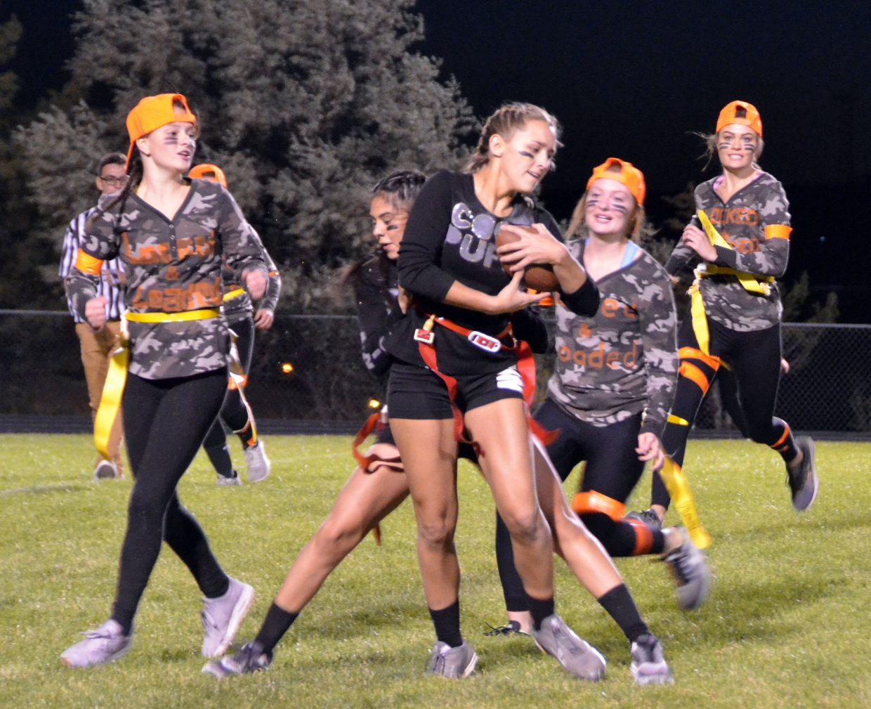 Coco Puffs' Kayla Hampton  looks to get away from the Locked & Loaded defenders during Moffat County High School's Monday Powder Puff Football.