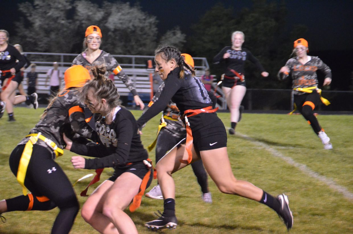 Coco Puffs' Jackie Barraza advances upfield during Moffat County High School's Monday Powder Puff Football.