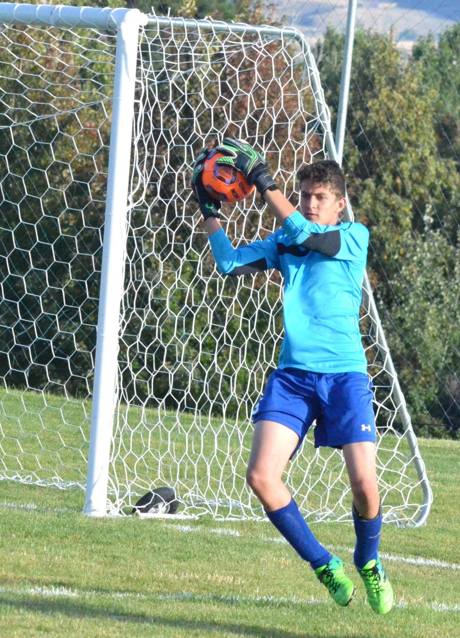 Moffat County High School goalie Sabastian Hershiser grabs a shot on the fly.