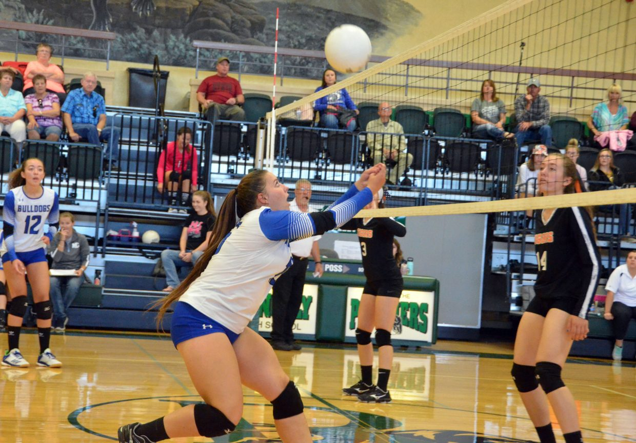 Moffat County High School's Ebawnee Smercina digs in at the net during Lady Bulldog volleyball's Saturday game against Hayden at the Rangely Fall Classic.
