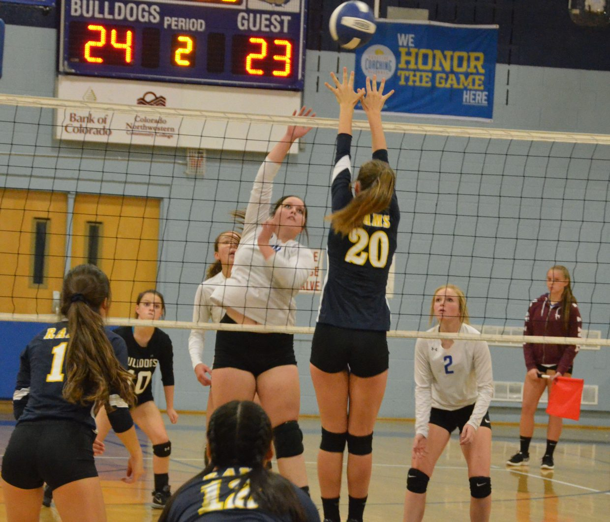 Moffat County High School's Taytum Smercina slams a spike against Roaring Fork at game point.