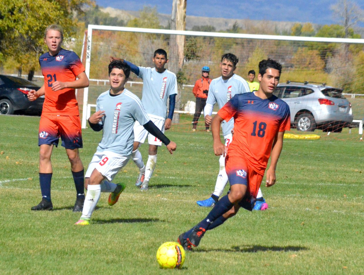 Colorado Northwestern Community College soccer players push forward during Spartan soccer's game with Snow College.