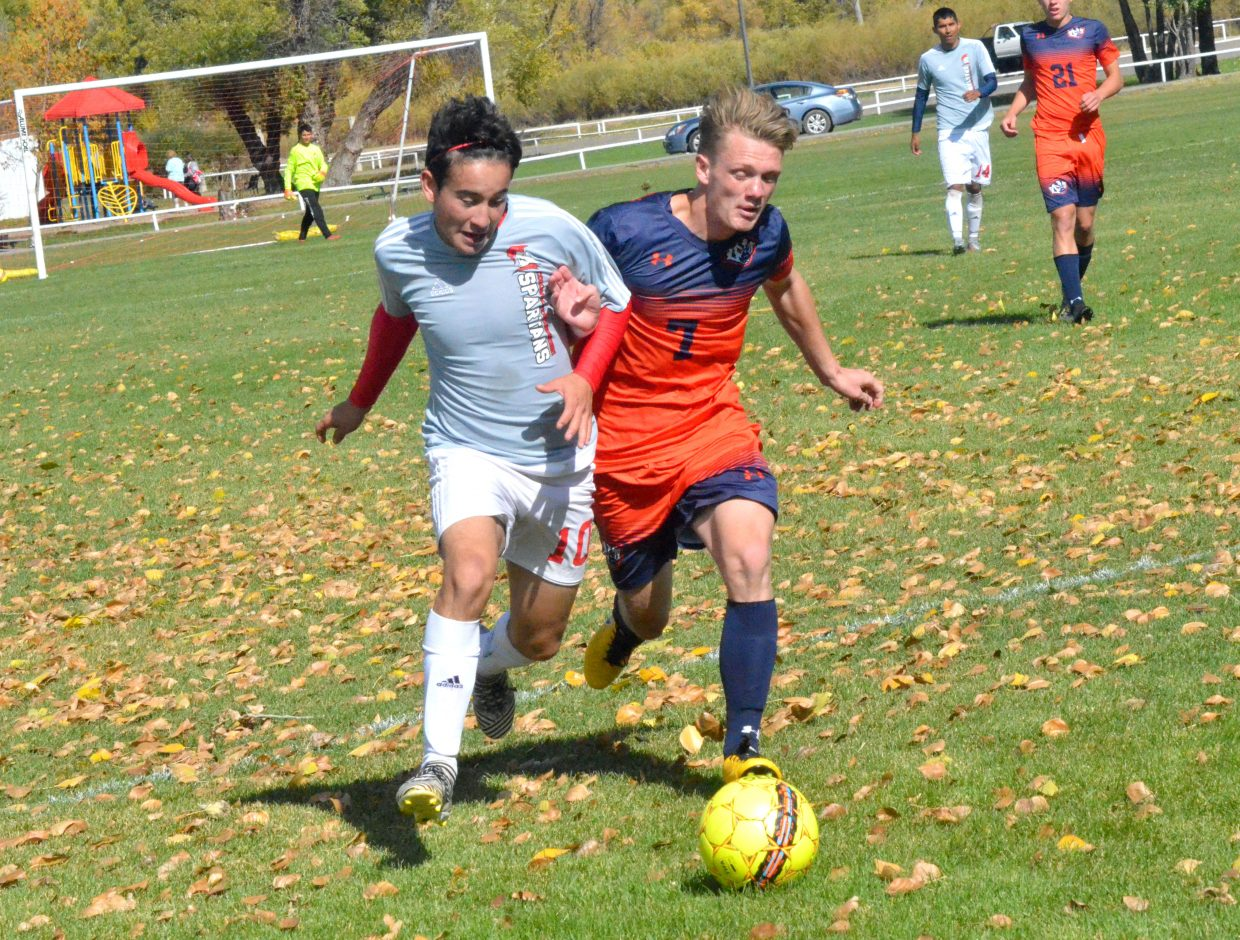 Colorado Northwestern Community College's Juan Loya races after the ball at midfield during  Spartan soccer's game with Snow College.