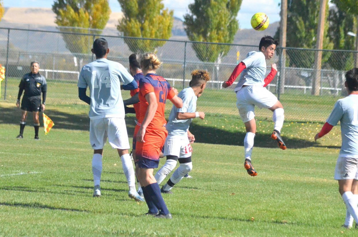 Colorado Northwestern Community College's Cameron Aragon uses his head to move the ball along during Spartan soccer's game with Snow College.