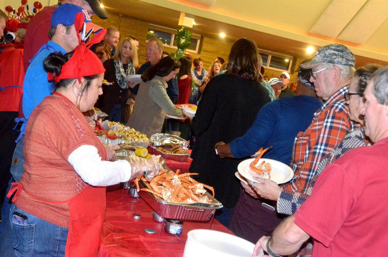 A long line of Craig patrons await their crab legs and other fixings during Craig Chamber of Commerce Crabfest.