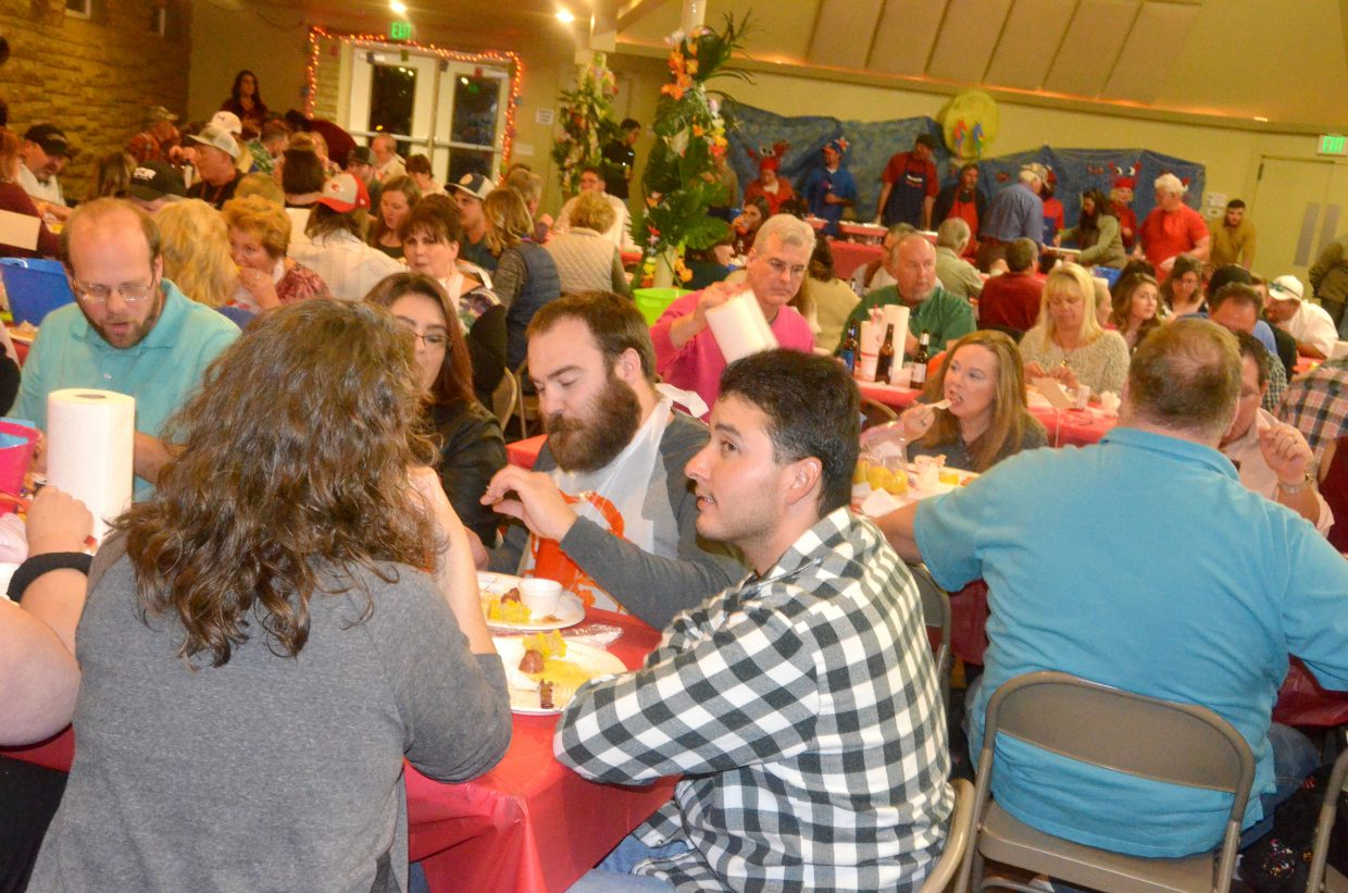 Patrons dig into their meals, including king crab legs, during Saturday's Craig Chamber of Commerce Crabfest