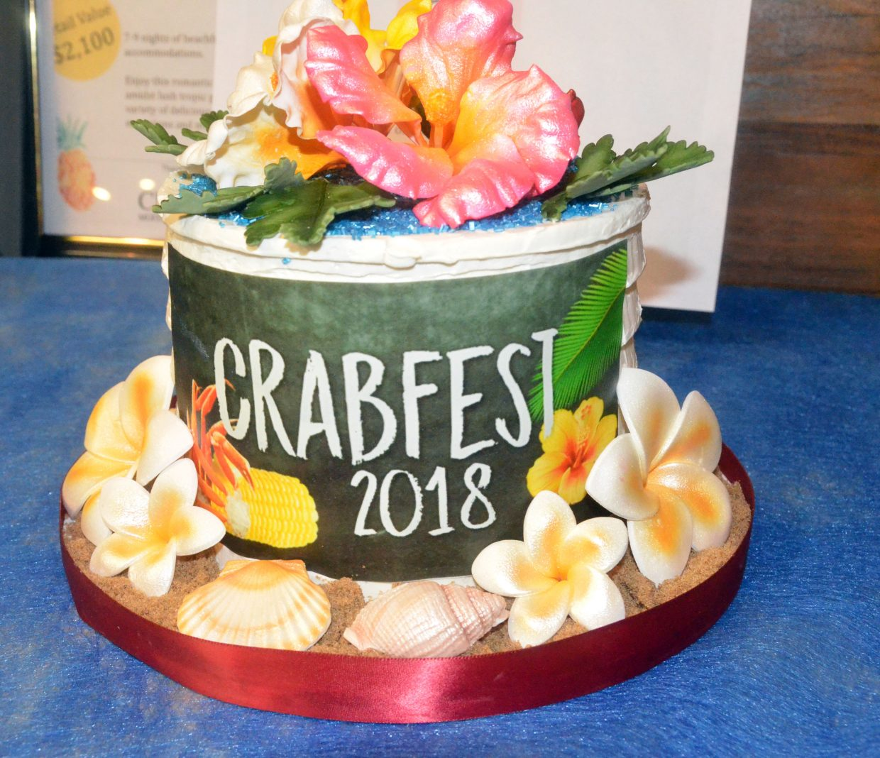 A decorative cake is up for bids in the silent auction at Moffat County Fairgrounds Pavilion during Craig Chamber of Commerce Crabfest.