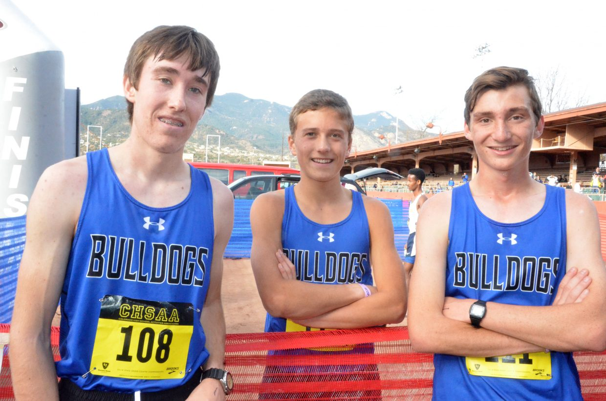 From left, Moffat County High School cross country runners Chris Carrouth, Wyatt Mortenson and AJ Barber gather following the CHSAA State Championships in Colorado Springs.