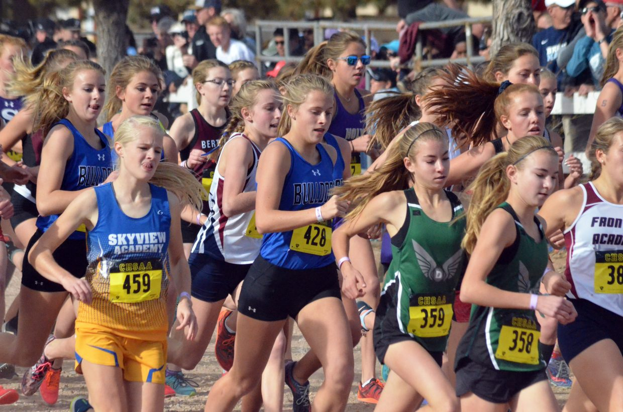 From left, Moffat County High School's Halle Hamilton, Liberty Hippely and Kelsey McDiffett make their way among the throng of runners at the CHSAA State Championships in Colorado Springs.