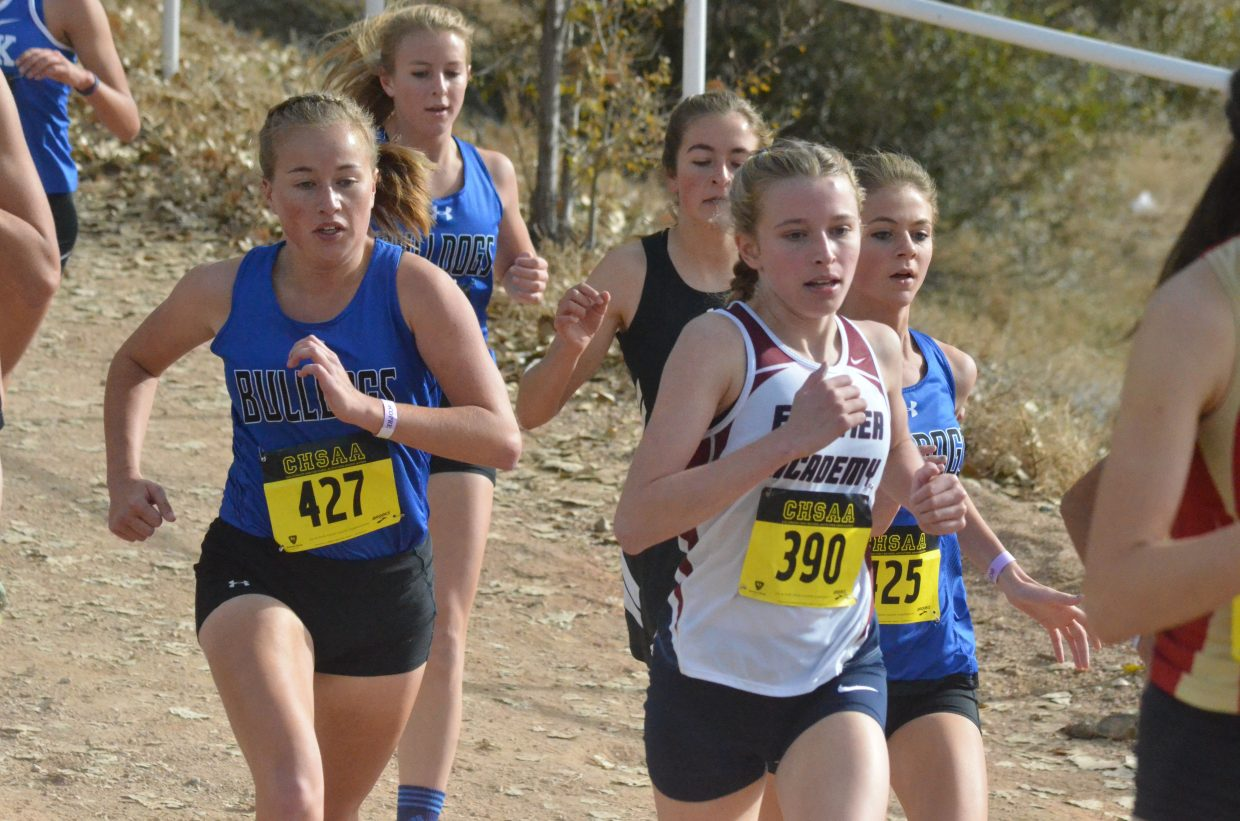 From left, Moffat County High School cross country runners Makenna Knez, Halle Hamilton and Liberty Hippely get back on even ground at the CHSAA State Championships in Colorado Springs.