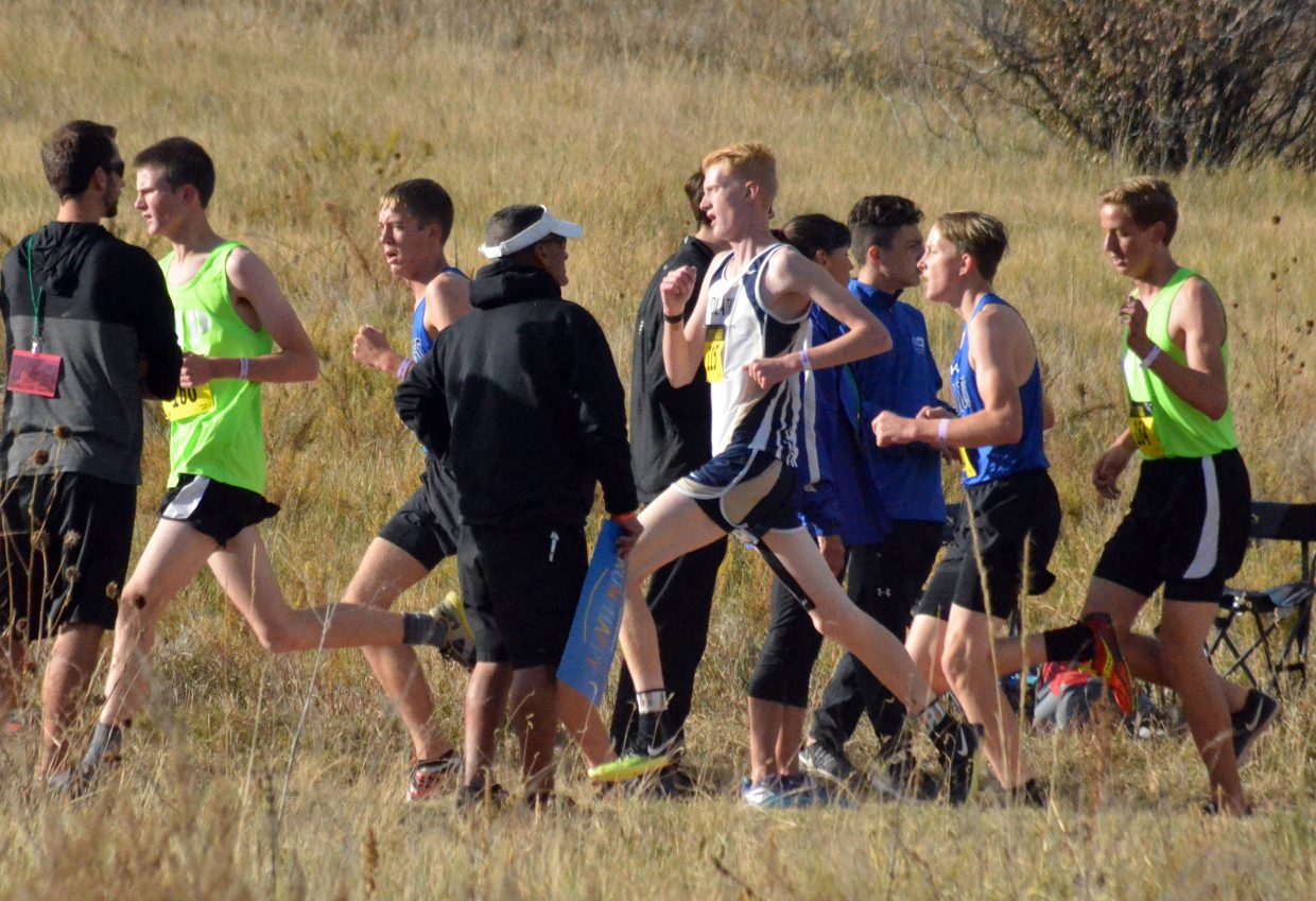 Moffat County High School cross country runners Theo Corrello and Logan Hafey pass by spectator on the high ground of the CHSAA State Championships in Colorado Springs.