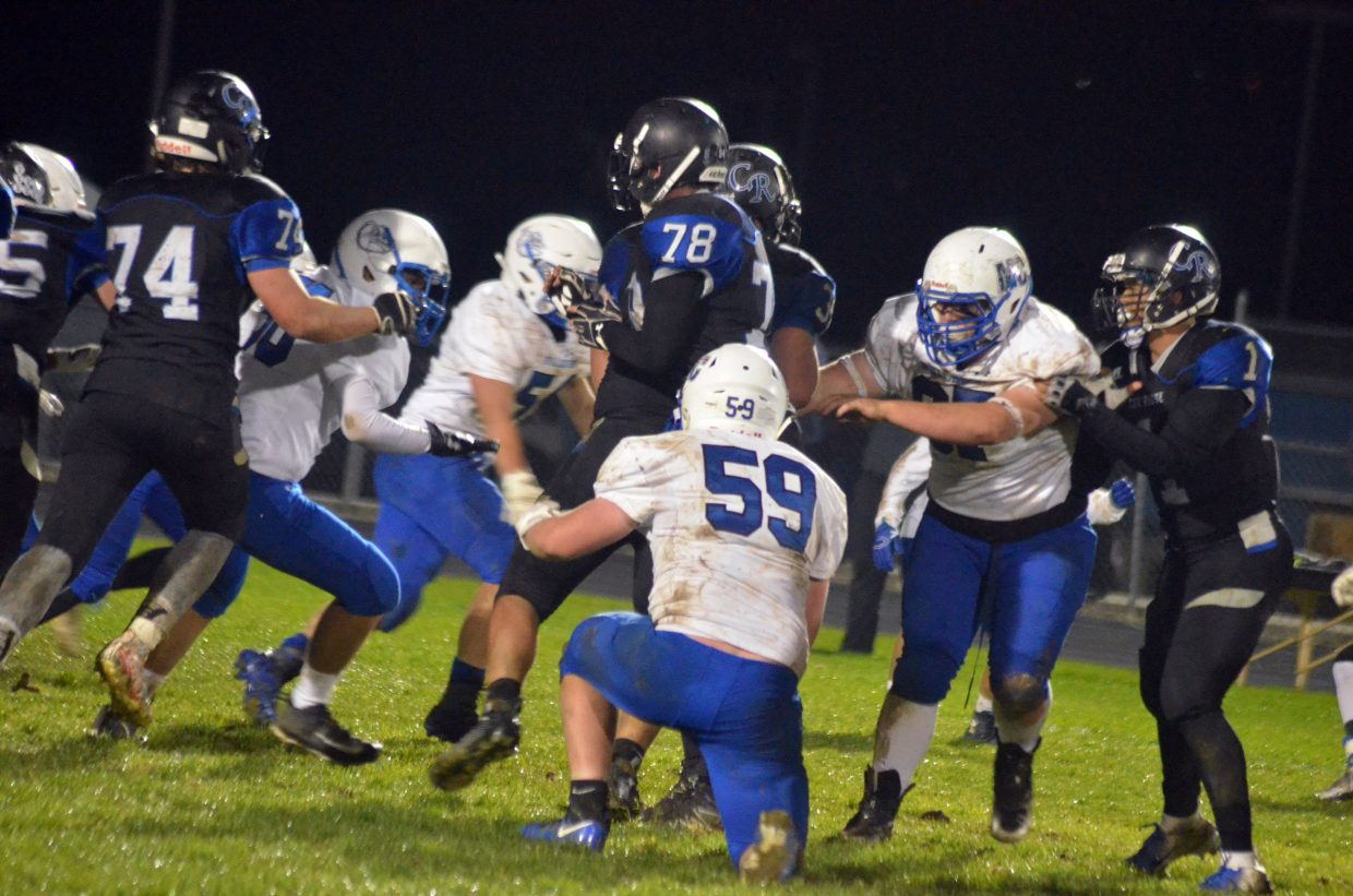 The Moffat County High School defense closes up to slow a Coal Ridge run.