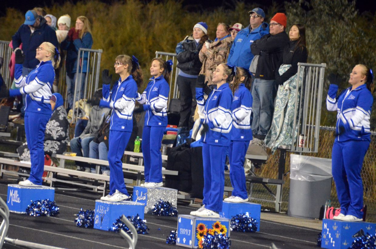 Moffat County High School cheerleaders and fans chant in support of the Bulldogs against Coal Ridge.