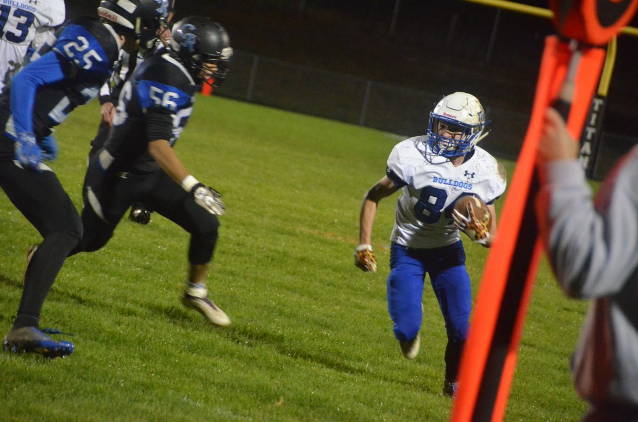 Moffat County High School's Dagan White is on the move along the sidelines during a punt return against Coal Ridge.