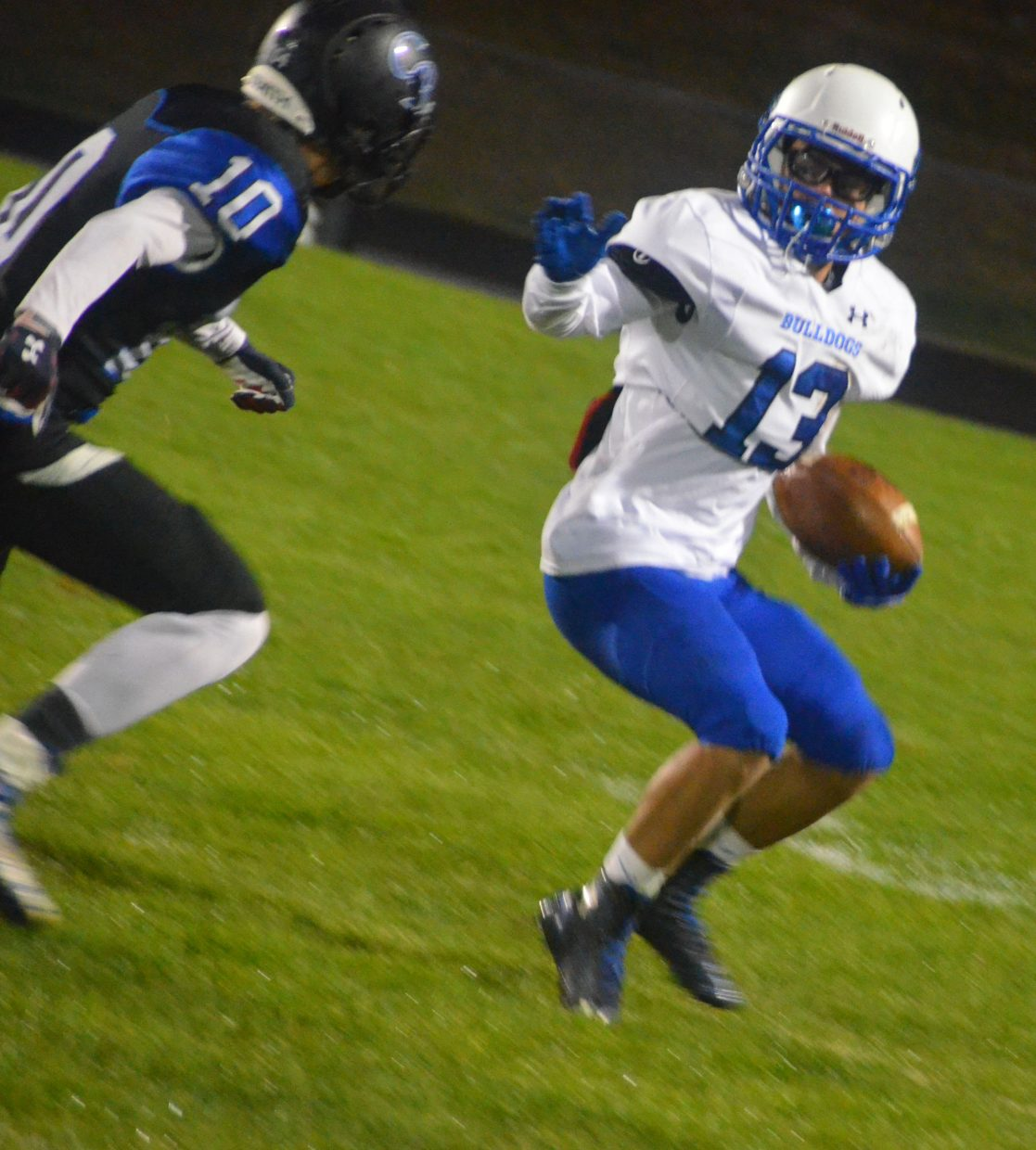 Moffat County High School's Victor Silva looks to get around the Coal Ridge defense.