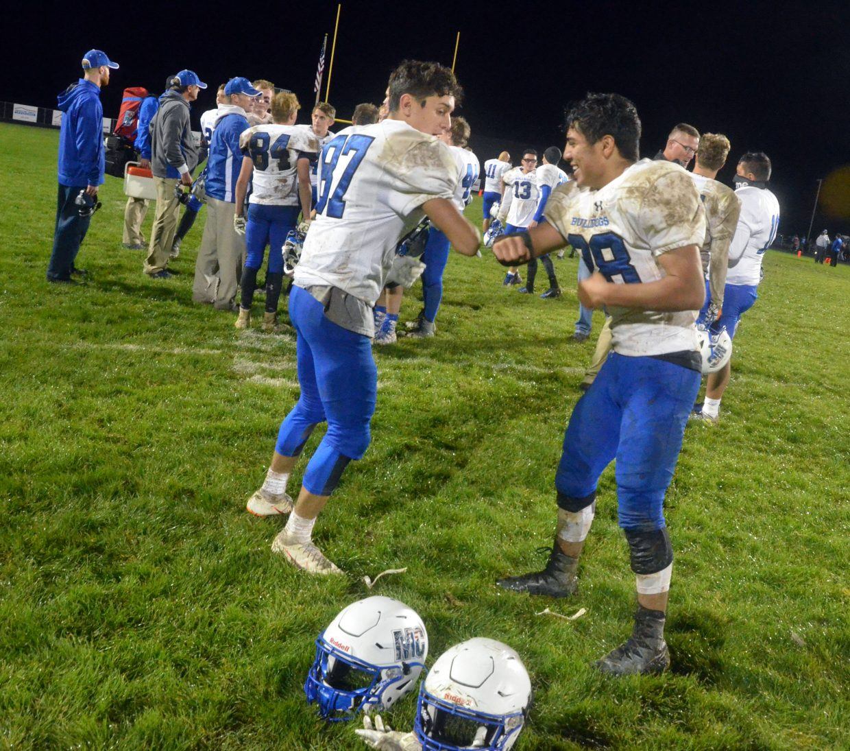Moffat County High School football players Dario Alexander, left, and Kevin Hernandez share a specialty handshake after a win over Coal Ridge.