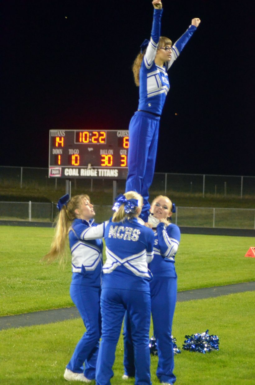 Moffat County High School  cheerleaders perform stunt work during halftime against Coal Ridge.