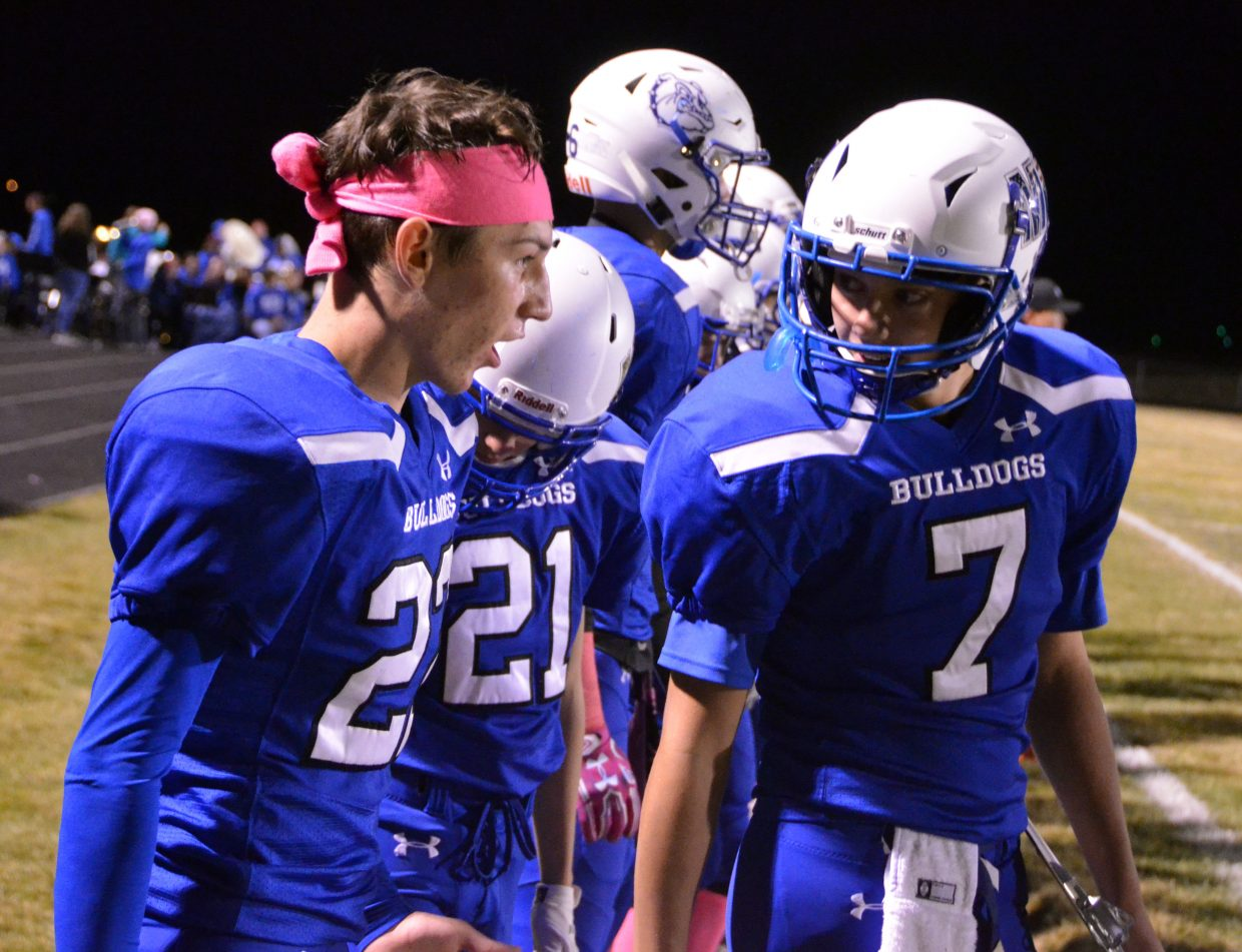 From left, Moffat County High School's Connor Etzler, Chris Maneotis and Ryan Peck talk excitedly on the sidelines.