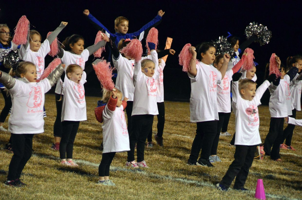 Members of the Junior Bulldog Fall Cheer Clinic make some noise during the group's halftime routine.