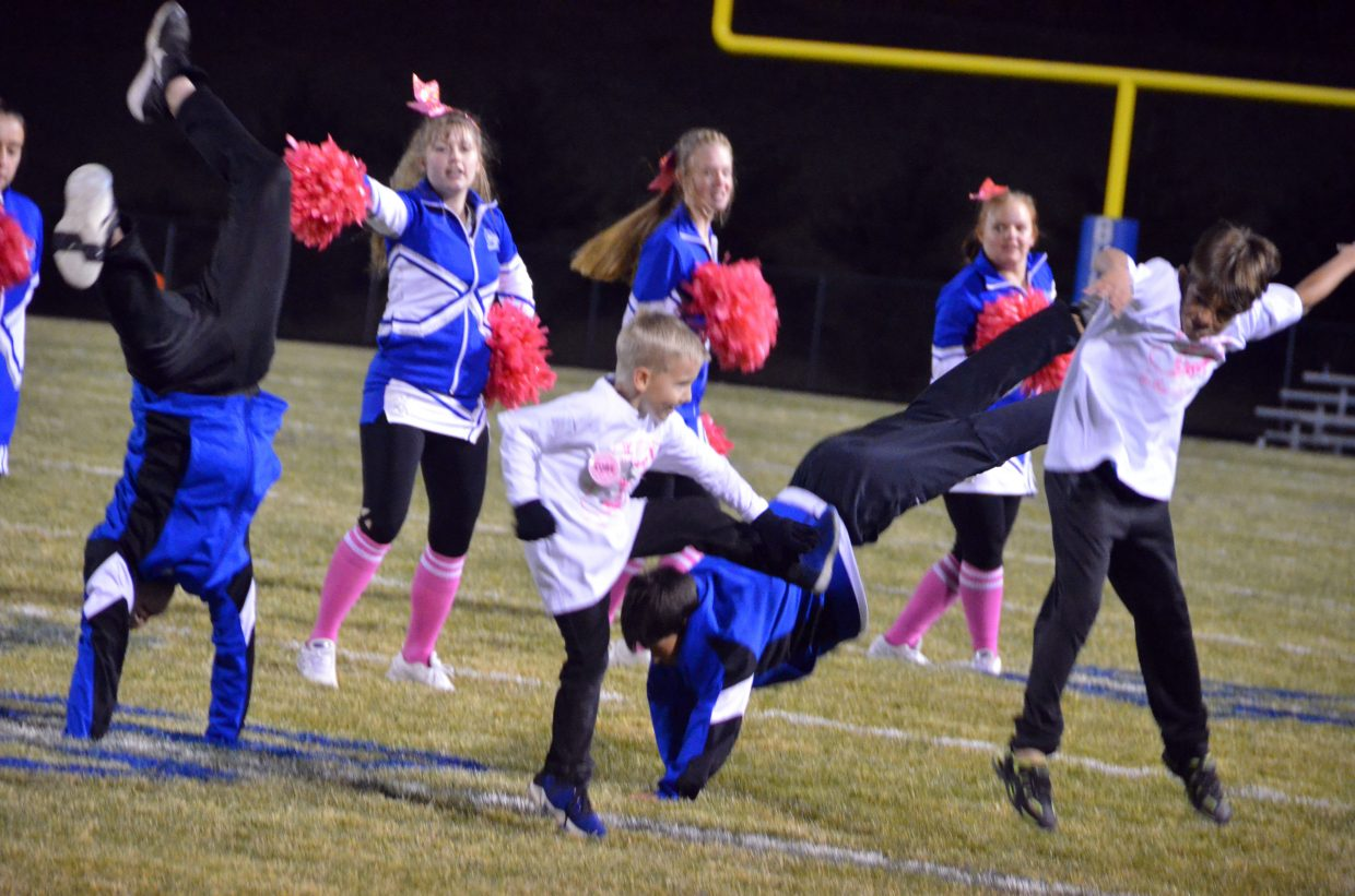 Members of the Junior Bulldog Fall Cheer Clinic perform stunts during the group's halftime routine.