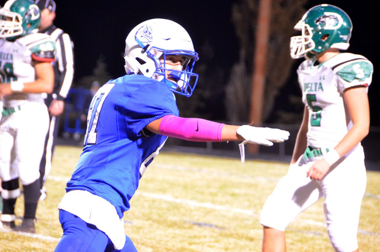 Moffat County High School's Dario Alexander motions to refs as an eligible receiver.