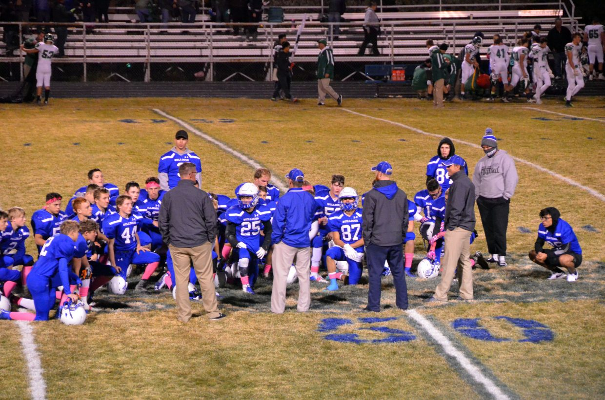Moffat County High School football players take a knee at midfield following the loss to Delta.