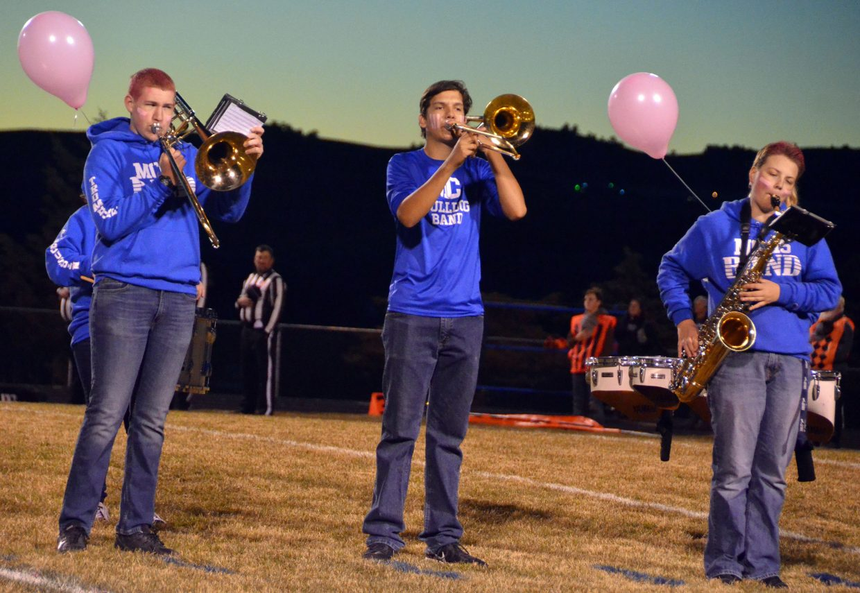 The Moffat County High School band performs the national anthem before the Bulldogs' Pink Game.