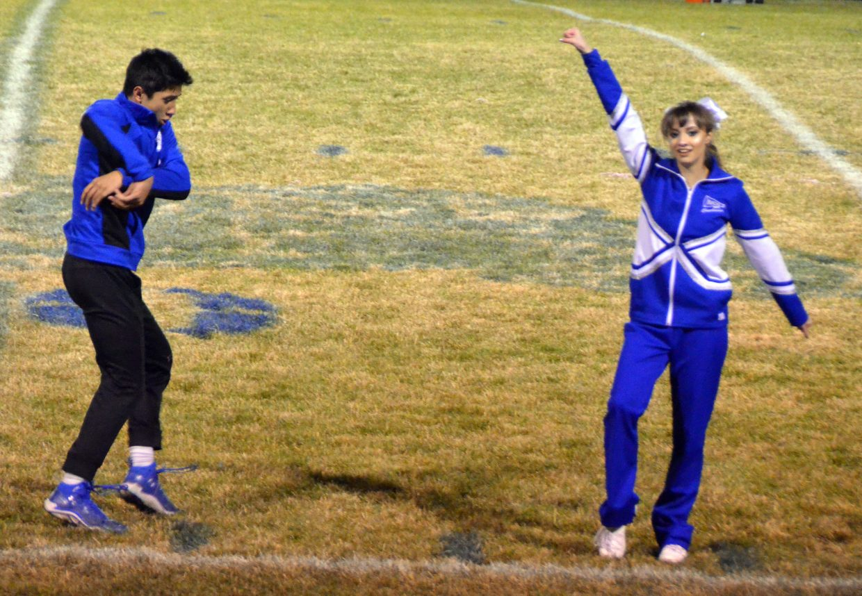 Moffat County High School's Sambu Shrestha and Abigail Hall perform a two-person dance routine at halftime.