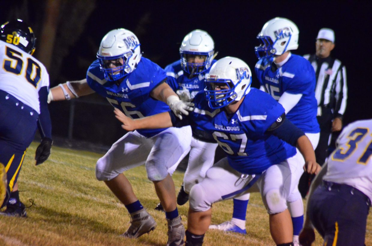 Moffat County High School's Jared Baker and Drake Doherty get in motion on the Bulldog line.