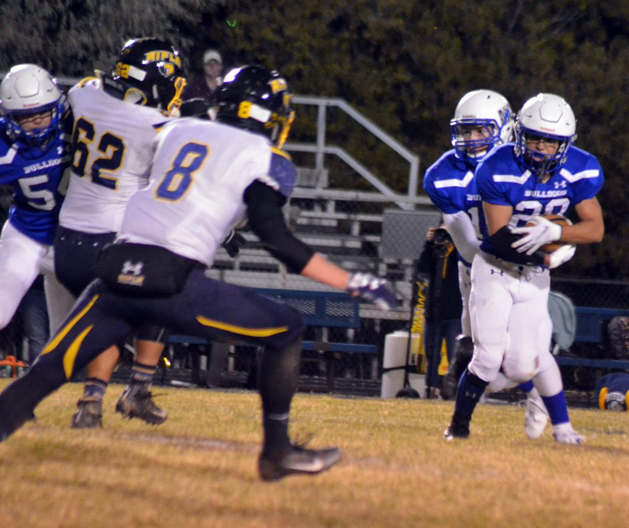 Moffat County High School's Kevin Hernandez takes the handoff from Colby Beaver.