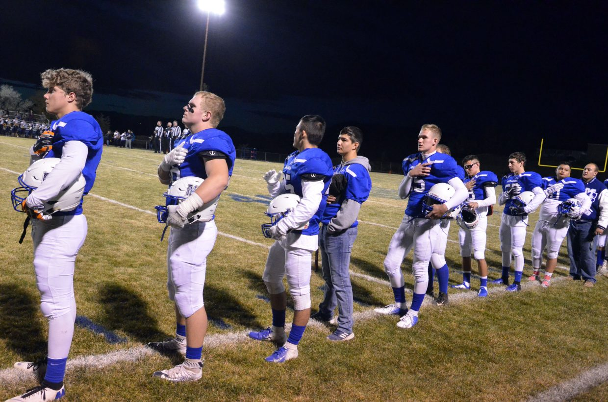 Moffat County High School seniors line up for the national anthem.