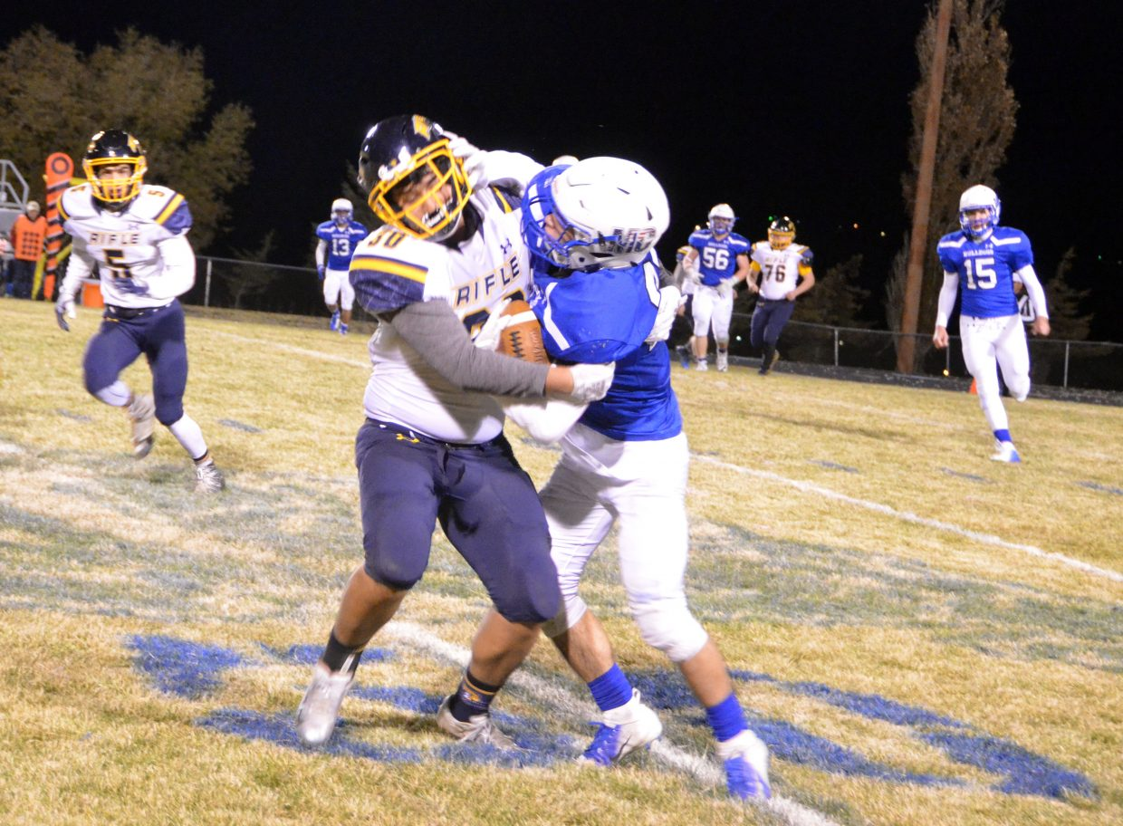 Moffat County High School's Josh Teeter fights for every inch after a lateral from Connor Etzler.